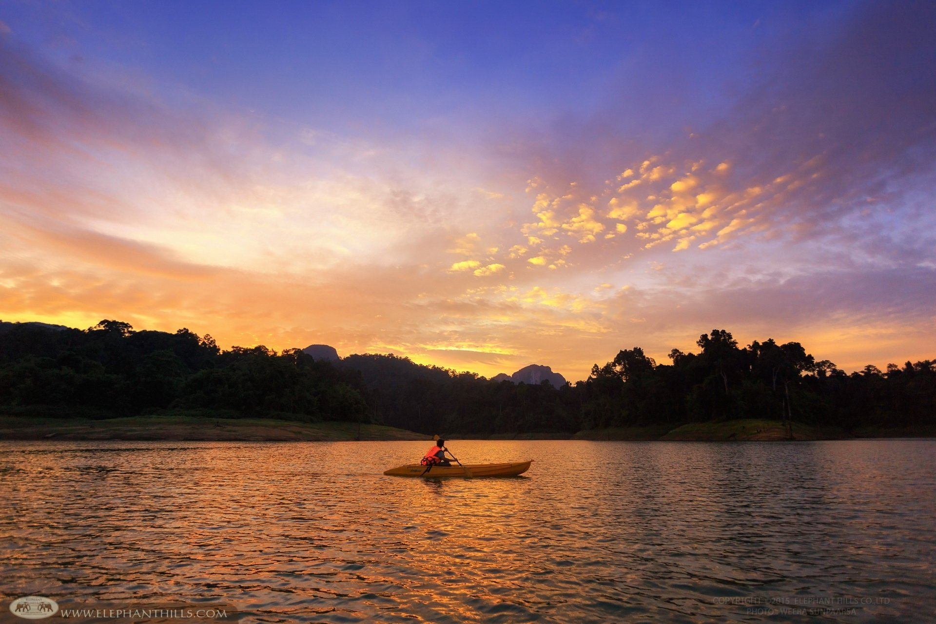 Activities in Khao Sok National Park include kayaking down the river and enjoying breathtaking rainforest views