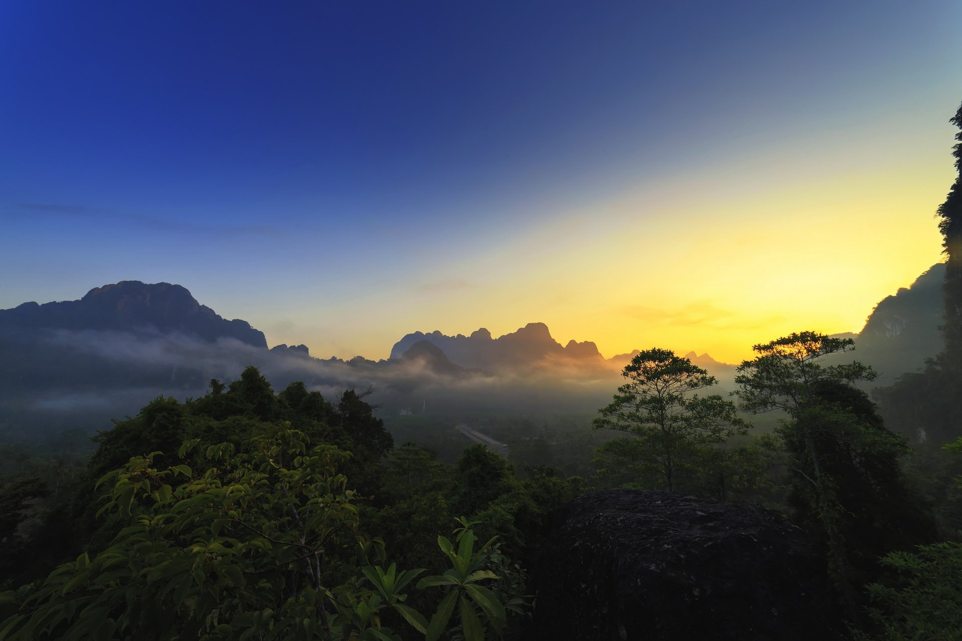 Sunrise over the rainforest in Khao Sok National Park, Thailand.